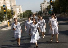 Israelis walk in the middle of an empty street during the Jewish holiday of Yom Kippur in Jerusalem, Thursday, Oct. 9, 2008. Yom Kippur, or 'Day of Atonement,' is the holiest of Jewish holidays when observant Jews atone for the sins of the past year and the nation comes to almost a complete standstill. (AP Photo/Bernat Armangue)